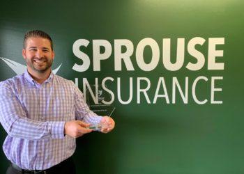 Derek Sprouse with award