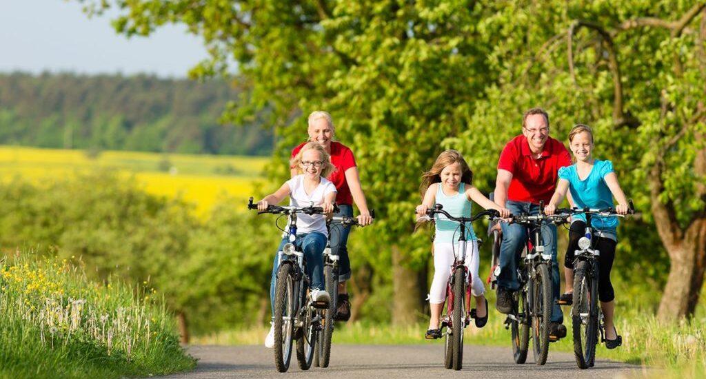 Family riding bikes, insurance